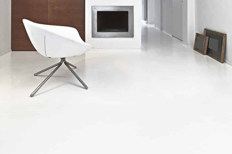 white leather modern armchair in front of the fireplace in the living room